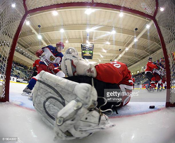 Goaltender Michael Tobler of Switzerland flops in his crease after making a save off the shot of Alexander Nikulin of Russia during the third period...
