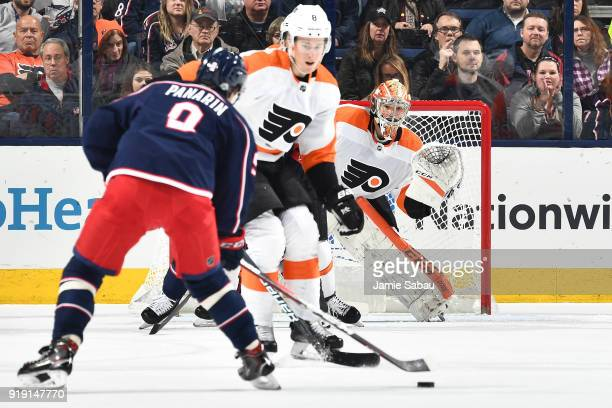 Goaltender Michal Neuvirth of the Philadelphia Flyers defends the net as Artemi Panarin of the Columbus Blue Jackets skates with the puck during the...