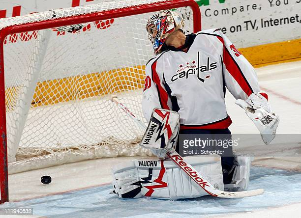Goaltender Michal Neuvirth of the Washington Capitals lets a goal score by Bill Thomas of the Florida Panthers at the BankAtlantic Center on April 9,...
