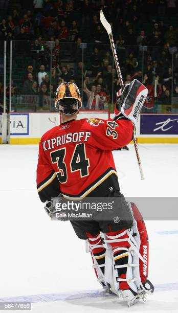 Goaltender Miikka Kiprusoff of the Calgary Flames acknowledges the fans after defeating the Boston Bruins in their NHL game at Pengrowth Saddledome...