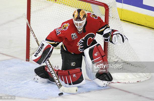 Goaltender Miikka Kiprusoff of the Calgary Flames blocks the puck against the Anaheim Mighty Ducks during NHL action in game five of the Western...