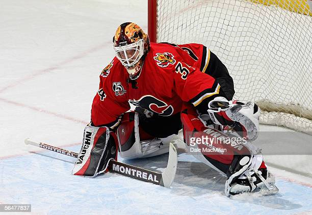 Goaltender Miikka Kiprusoff of the Calgary Flames defends his net against the Boston Bruins during their NHL game at Pengrowth Saddledome on December...