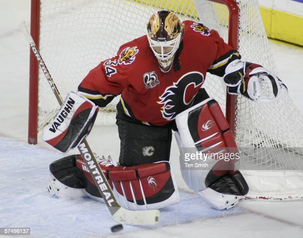 Goaltender Miikka Kiprusoff of the Calgary Flames deflects a shot on net in game five of the Western Conference Quarterfinals against the Anaheim...