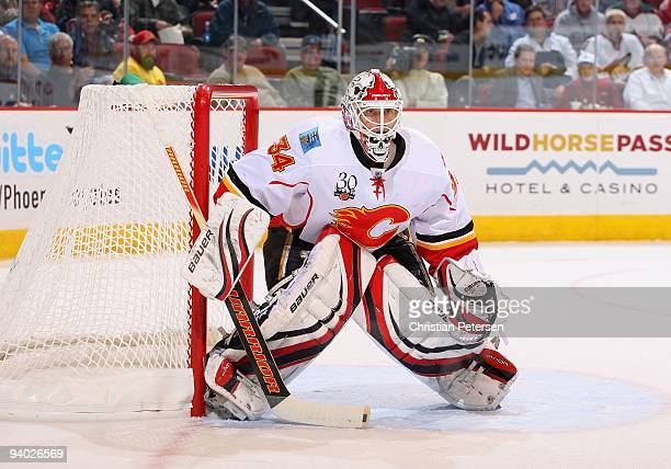 Goaltender Miikka Kiprusoff of the Calgary Flames during the NHL game against the Phoenix Coyotes at Jobingcom Arena on December 3 2009 in Glendale...