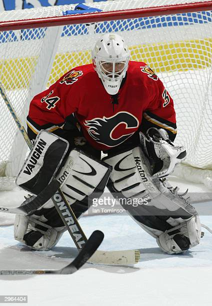 Goaltender Miikka Kiprusoff of the Calgary Flames faces the play during the game against the Chicago Blackhawks at the Pengrowth Saddledome on...