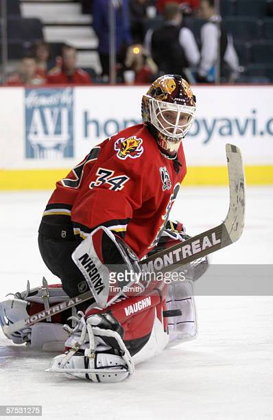 Goaltender Miikka Kiprusoff of the Calgary Flames follows the puck against the Anaheim Mighty Ducks in game one of the Western Conference...
