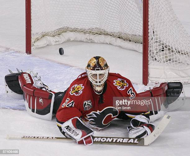 Goaltender Miikka Kiprusoff of the Calgary Flames lies sprawled on the ice after a goal by Samuel Pahlsson of the Anaheim Mighty Ducks during third...