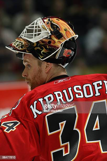 Goaltender Miikka Kiprusoff of the Calgary Flames looks on during a break in game action against the Boston Bruins during their NHL game at Pengrowth...