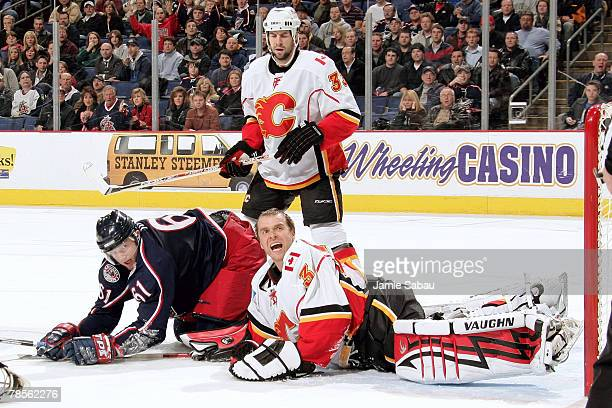 Goaltender Miikka Kiprusoff of the Calgary Flames looks up to the referee for a penalty call after Rick Nash ran into Kiprusoff and he lost his...