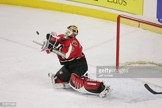 Goaltender Miikka Kiprusoff of the Calgary Flames makes a blocker save against the Anaheim Mighty Ducks in game seven of the Western Conference...