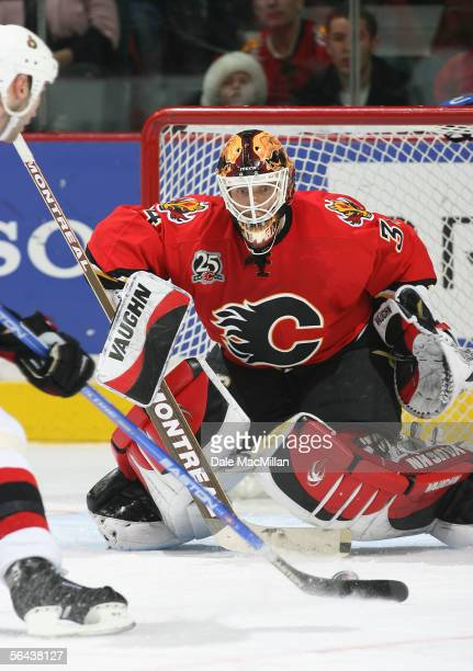 Goaltender Miikka Kiprusoff of the Calgary Flames makes a save against the Ottawa Senators during the NHL game at Pengrowth Saddledome on December 10...
