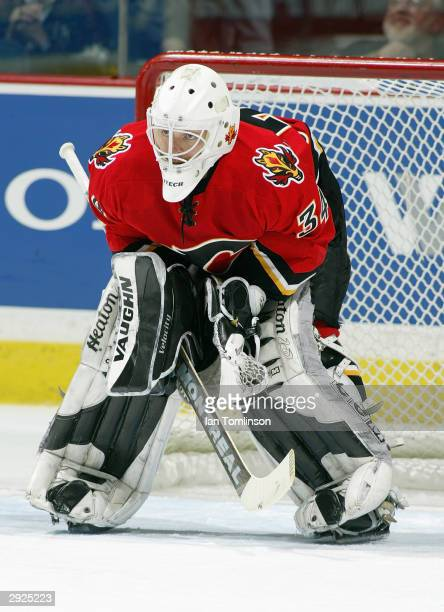 Goaltender Miikka Kiprusoff of the Calgary Flames protects the net during the game against the Montreal Canadians at Pengrowth Saddledome on November...