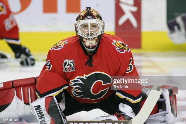 Goaltender Miikka Kiprusoff of the Calgary Flames stretches on the ice against the Anaheim Mighty Ducks before the NHL action in game five of the...