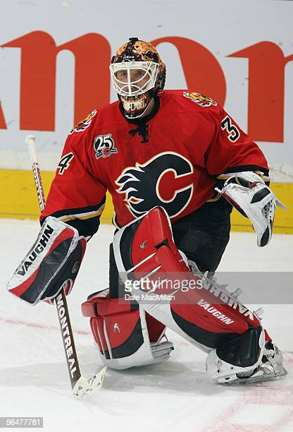 Goaltender Miikka Kiprusoff of the Calgary Flames warms up prior to taking on the Boston Bruins in an NHL game at Pengrowth Saddledome on December 17...