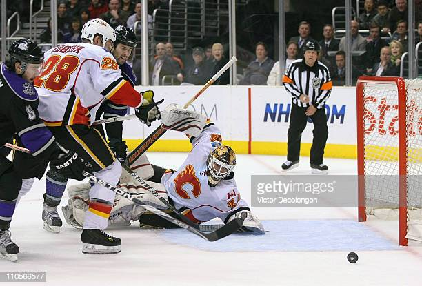 Goaltender Miikka Kiprusoff of the Calgary Flames watches as the puck goes wide of the net in the second period during the NHL game against the Los...