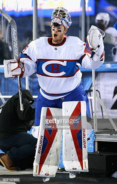 Goaltender Mike Condon of the Montreal Canadiens celebrates as he leaves the ice after his team defeated the Boston Bruins 51 in the 2016 Bridgestone...