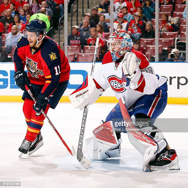 Goaltender Mike Condon of the Montreal Canadiens defends the net against Jonathan Huberdeau of the Florida Panthers at the BBT Center on April 2 2016...