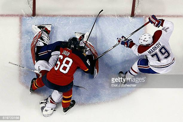 Goaltender Mike Condon of the Montreal Canadiens defends the net with the help of teammate Andrei Markov against Jaromir Jagr of the Florida Panthers...