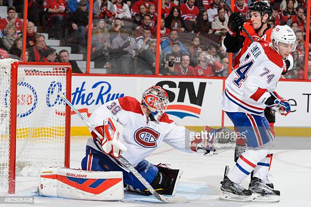 Goaltender Mike Condon of the Montreal Canadiens gets the glove out during the NHL game against the Ottawa Senators at Canadian Tire Centre on...