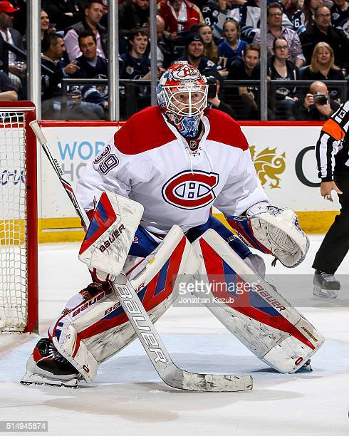 Goaltender Mike Condon of the Montreal Canadiens guards the net during second period action against the Winnipeg Jets at the MTS Centre on March 5...