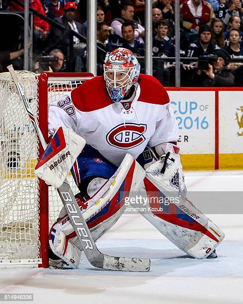 Goaltender Mike Condon of the Montreal Canadiens keeps an eye on the play as he guards the net during second period action against the Winnipeg Jets...