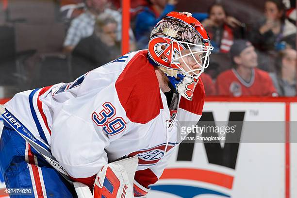 Goaltender Mike Condon of the Montreal Canadiens looks on as he plays his first NHL game against the Ottawa Senators and records his first career win...