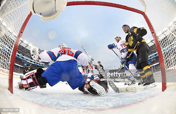 Goaltender Mike Condon of the Montreal Canadiens makes a glove save on a shot by Ryan Spooner of the Boston Bruins in the second period of the 2016...