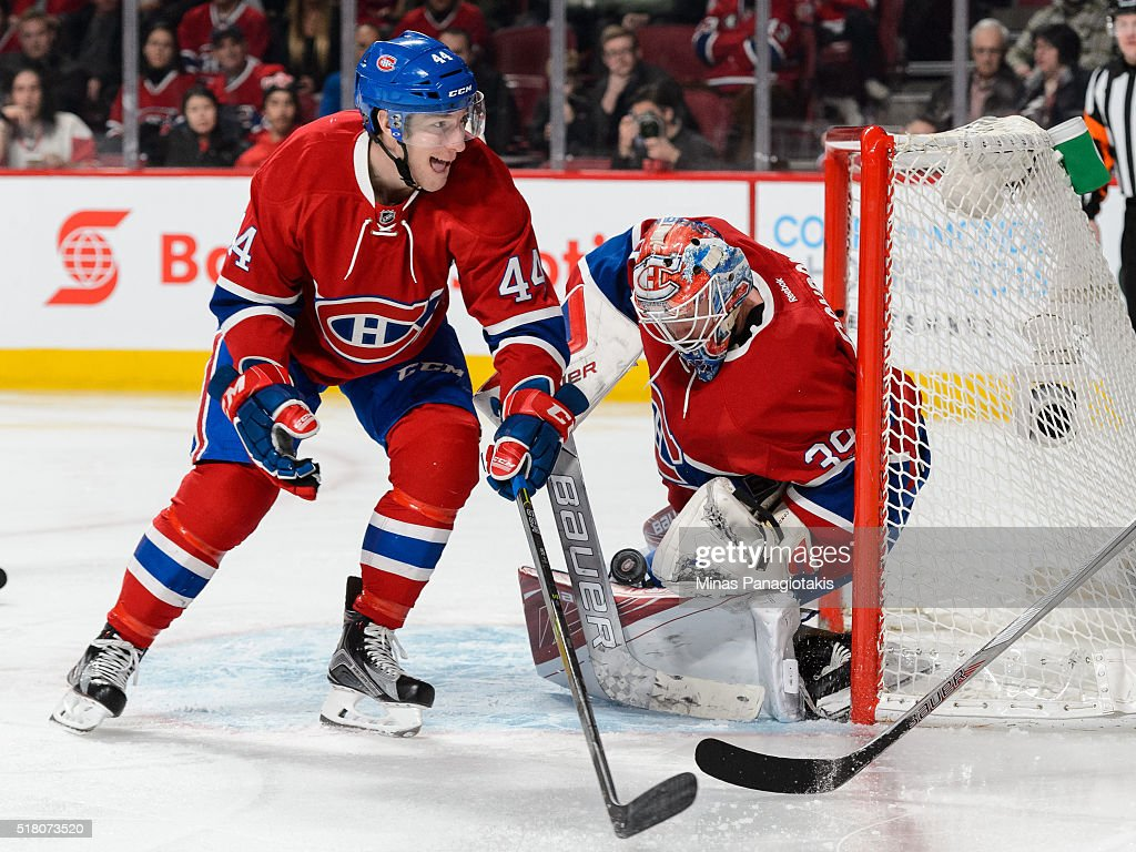 Goaltender Mike Condon #39 of the Montreal Canadiens makes a save near teammate Darren Dietz #44 during the NHL game against the Detroit Red Wings at the Bell Centre on March 29, 2016 in Montreal, Quebec, Canada. The Montreal Canadiens defeated the Detroit Red Wings 4-3.