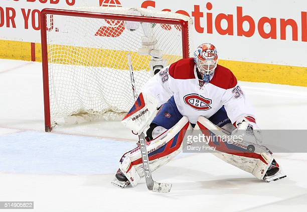 Goaltender Mike Condon of the Montreal Canadiens plays the puck to the side of the net during second period action against the Winnipeg Jets at the...