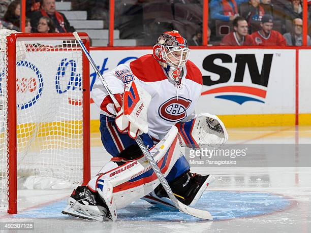 Goaltender Mike Condon of the Montreal Canadiens protects his net and wins his first ever NHL game against the Ottawa Senators at Canadian Tire...