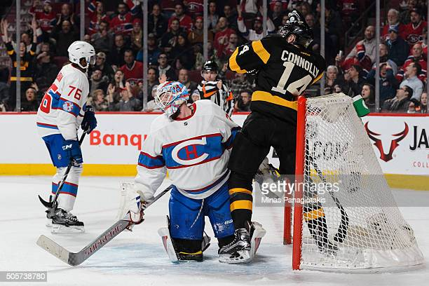 Goaltender Mike Condon of the Montreal Canadiens reacts after allowing a goal as Brett Connolly of the Boston Bruins skates behind him during the NHL...
