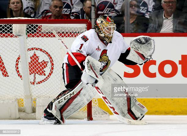 Goaltender Mike Condon of the Ottawa Senators guards the net during first period action against the Winnipeg Jets at the MTS Centre on April 1 2017...