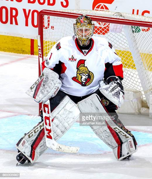 Goaltender Mike Condon of the Ottawa Senators guards the net during second period action against the Winnipeg Jets at the MTS Centre on April 1 2017...