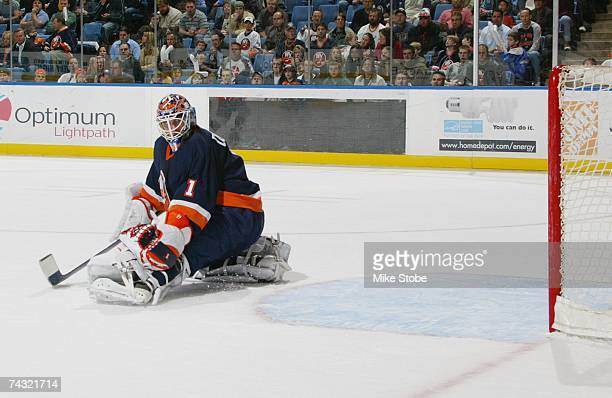 Goaltender Mike Dunham of the New York Islanders looks over his shoulder at a shot by the New Jersey Devils during their NHL game on March 27, 2007...