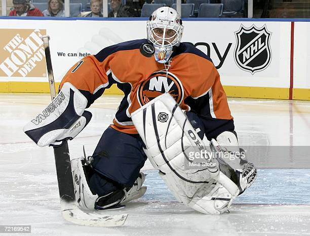 Goaltender Mike Dunham of the New York Islanders watches the puck after making a pad save against the Boston Bruins during their game on October 14,...