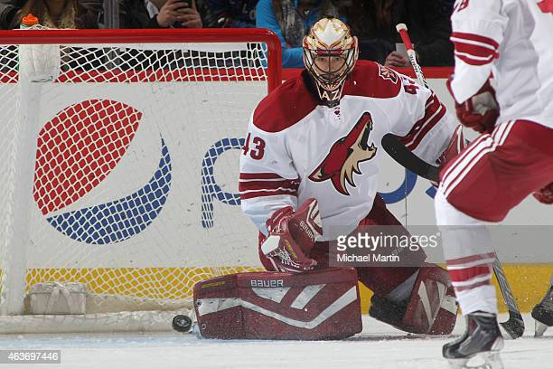 Goaltender Mike McKenna of the Arizona Coyotes plays in his first NHL appearance against the Colorado Avalanche at the Pepsi Center on February 16...