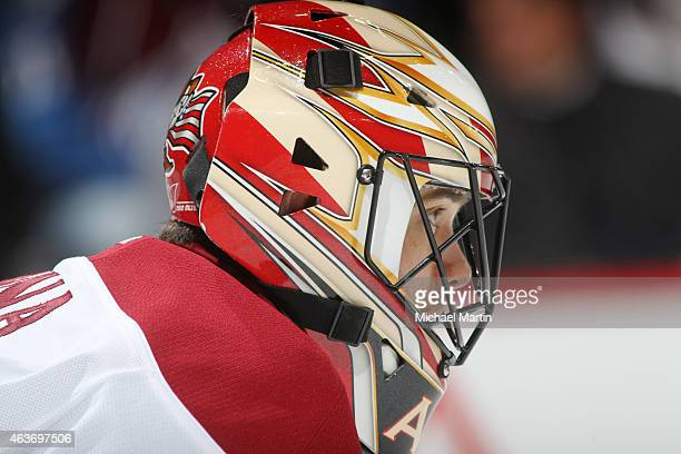 Goaltender Mike McKenna of the Arizona Coyotes stands ready against the Colorado Avalanche at the Pepsi Center on February 16 2015 in Denver Colorado...