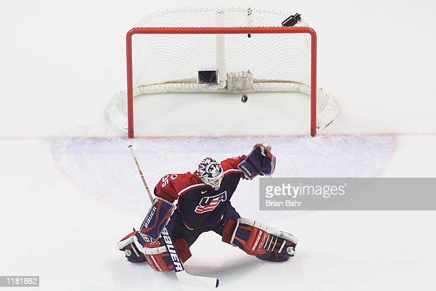 Goaltender Mike Richter of the USA reaches to make a save as the puck gets past him in the men's ice hockey semifinal against Russia during the Salt...
