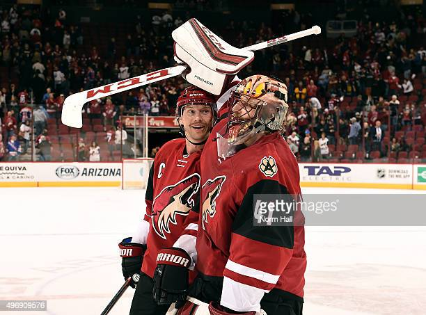 Goaltender Mike Smith and Shane Doan of the Arizona Coyotes celebrate a 41 victory against the Edmonton Oilers at Gila River Arena on November 12...