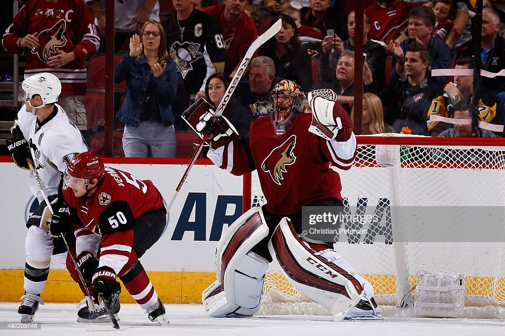 Goaltender Mike Smith #41 of the Arizona Coyotes celebrates after defeating the Pittsburgh Penguins 2-1 in the NHL game at Gila River Arena on October 10, 2015 in Glendale, Arizona.