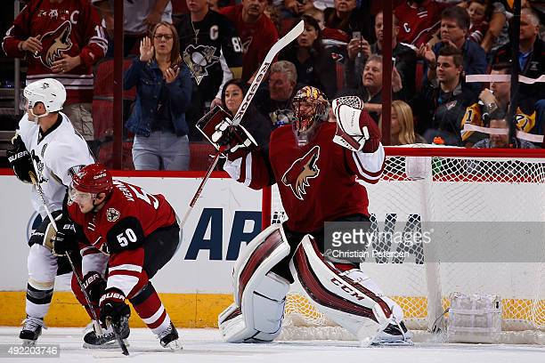 Goaltender Mike Smith of the Arizona Coyotes celebrates after defeating the Pittsburgh Penguins 2-1 in the NHL game at Gila River Arena on October...
