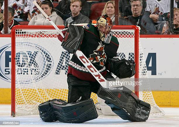 Goaltender Mike Smith of the Arizona Coyotes makes a blocker save against the Calgary Flames during the third period at Gila River Arena on November...