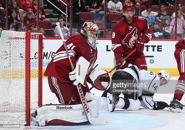 Goaltender Mike Smith of the Arizona Coyotes protects the net from a shot from the Los Angeles Kings during the second period of the preseason NHL...
