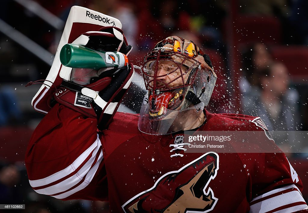 Goaltender Mike Smith #41 of the Arizona Coyotes sprays water in his face during a break from the second period of the NHL game against the St. Louis Blues at Gila River Arena on January 6, 2015 in Glendale, Arizona.