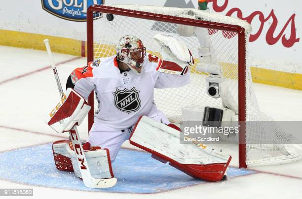 Goaltender Mike Smith of the Calgary Flames can't make the save on a shot for a goal during the 2018 Honda NHL AllStar Game between the Atlantic...