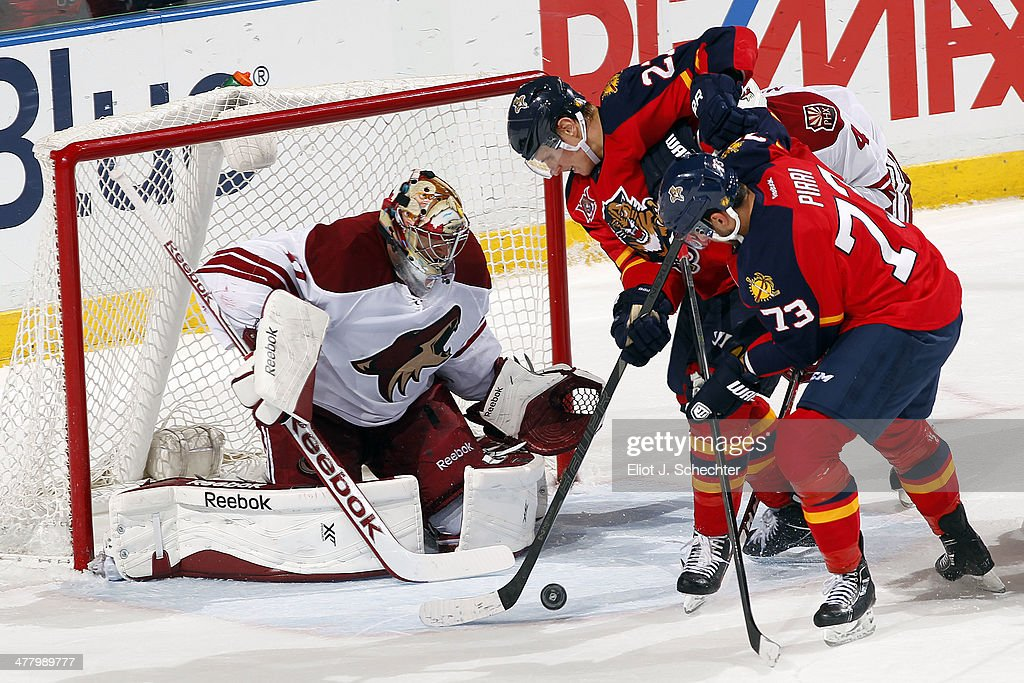 Goaltender Mike Smith #41 of the Phoenix Coyotes defends the net against Nick Bjugstad #27 and Brandon Pirri #73 of the Florida Panthers at the BB&T Center on March 11, 2014 in Sunrise, Florida.