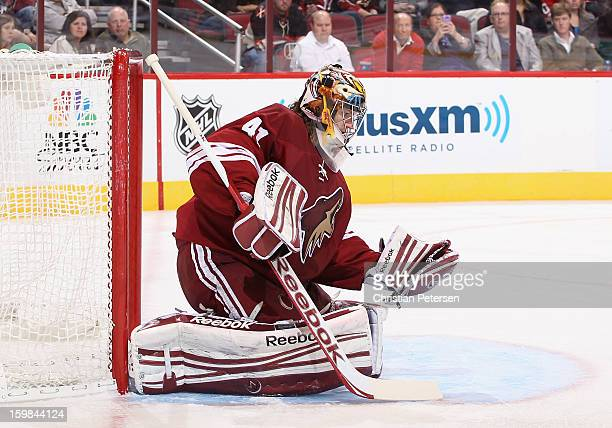 Goaltender Mike Smith of the Phoenix Coyotes makes a glove save during the NHL game against the Chicago Blackhawks at Jobingcom Arena on January 20...