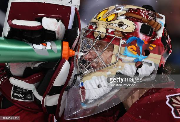 Goaltender Mike Smith of the Phoenix Coyotes sprays water in his face during a break from the NHL game against the Columbus Blue Jackets at Jobingcom...