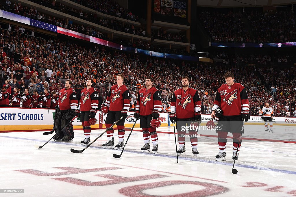 Goaltender Mike Smith #41, Oliver Ekman-Larsson #23, Connor Murphy #5, Jordan Martinook #48, Brad Richardson #15 and Shane Doan #19 of the Arizona Coyotes stand on the blue line during the national anthem prior to the start of a game against the Philadelphia Flyers at Gila River Arena on October 15, 2016 in Glendale, Arizona.