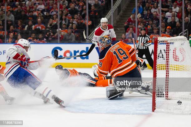 Goaltender Mikko Koskinen of the Edmonton Oilers cant stop Jeff Petry of the Montreal Canadiens from scoring while taking pressure from Montreals...